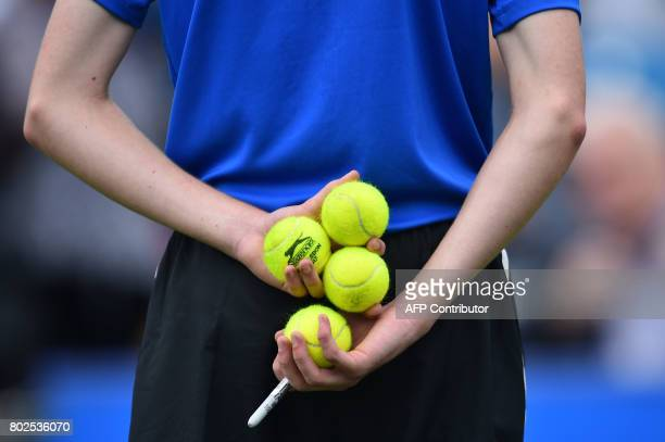 Ball-boy stands as Serbian tennis player and world number four, Novak Djokovic and Canadian Vasek Pospisil play their men's singles round two tennis...