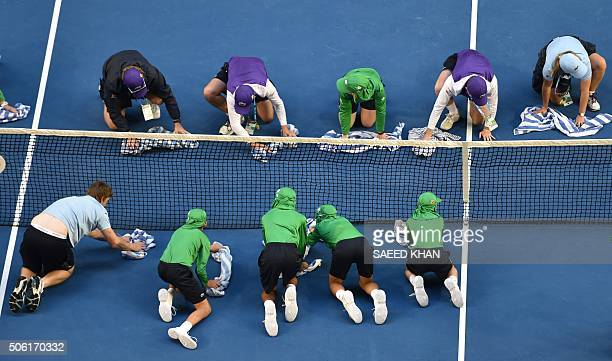 TOPSHOT Ballboys dry the court following Russia's Maria Sharapova's win against Lauren Davis of the US during their women's singles match on day five...