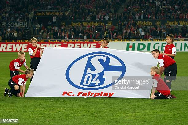 Ballboys show a banner during the Bundesliga match between 1 FC Koeln and FC Schalke 04 at the RheinEnergie stadium on September 26 2008 in Cologne...
