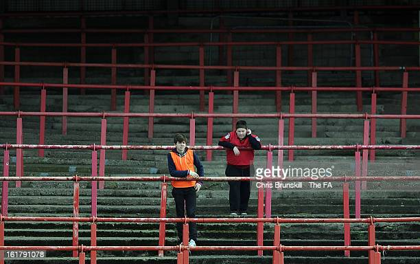 Ballboys watch on from an empty stand during the FA Trophy Semi-Final match between Wrexham and Gainsborough Trinity at the Racecourse Ground on...