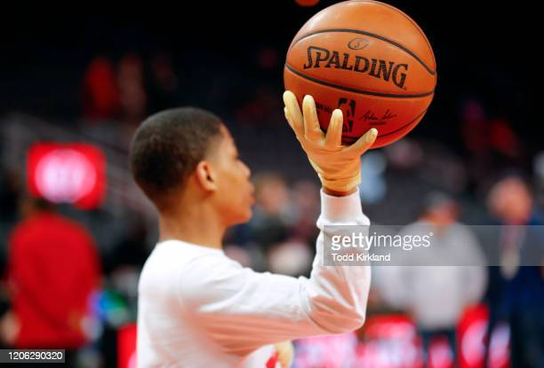 Ballboys wear gloves while handling warmup basketballs as a precautionary measure prior to an NBA game between the Charlotte Hornets and Atlanta...