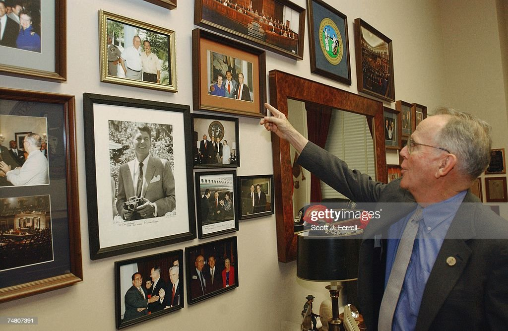 BALLENGER--Cass Ballenger, R-N.C., shows off a wall of photos in his office in Rayburn of his visits over the years with past and present presidents of countries in Central and South America -- which surround a photo of former U.S. President Ronald Reagan.