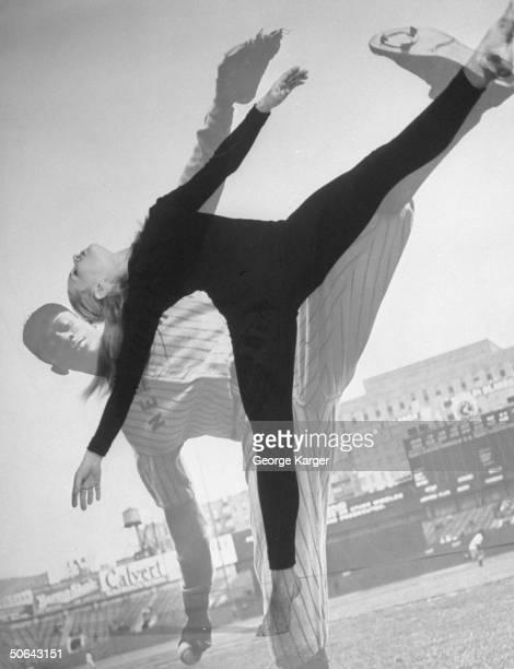 Ballerina Ann Dunbar duplicating pose of baseball pitcher Satchel Paige.