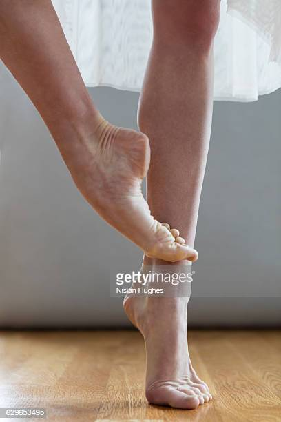 Ballerina bare foot on pointe