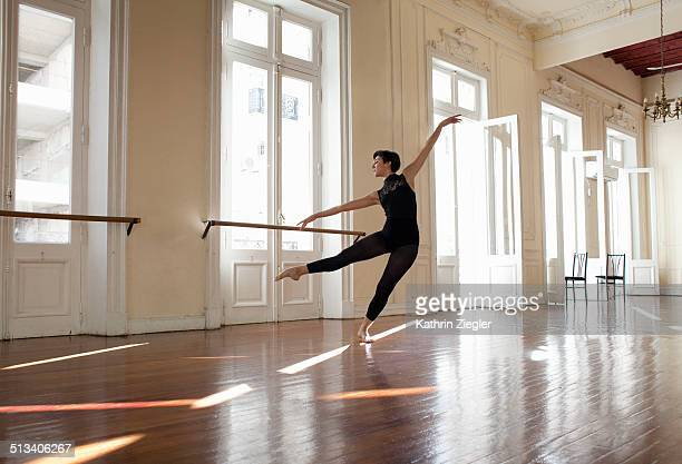 ballerina dancing in beautiful rehearsal room - ballet dancer stock pictures, royalty-free photos & images