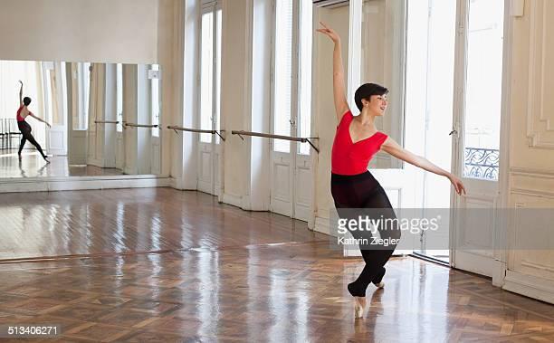 ballerina dancing in beautiful rehearsal room - ballettstudio stock-fotos und bilder