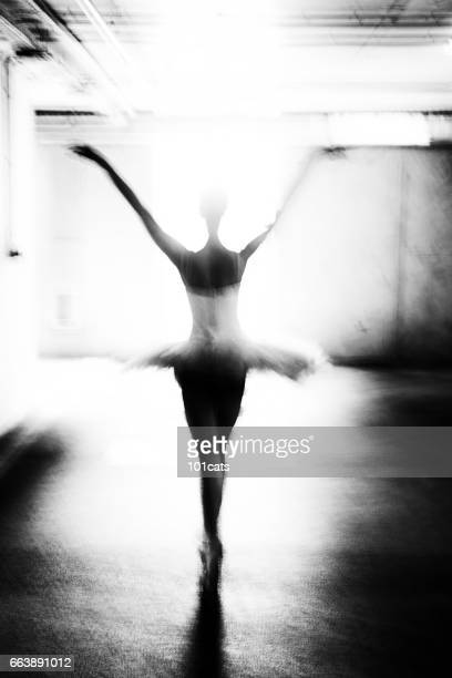 ballerina dancing in the garage - ballet dancer stock pictures, royalty-free photos & images