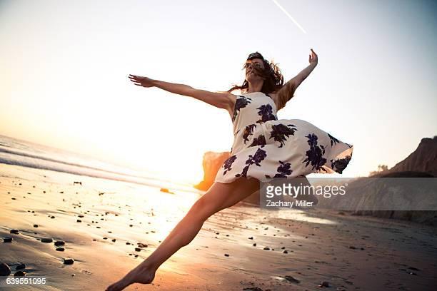 Ballerina dancing on beach