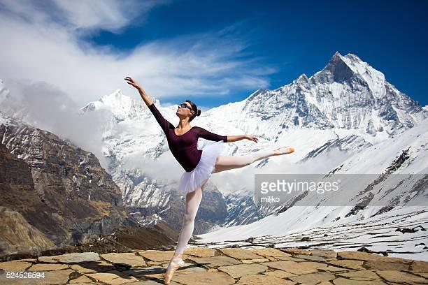 Ballerina dancing on high mountains