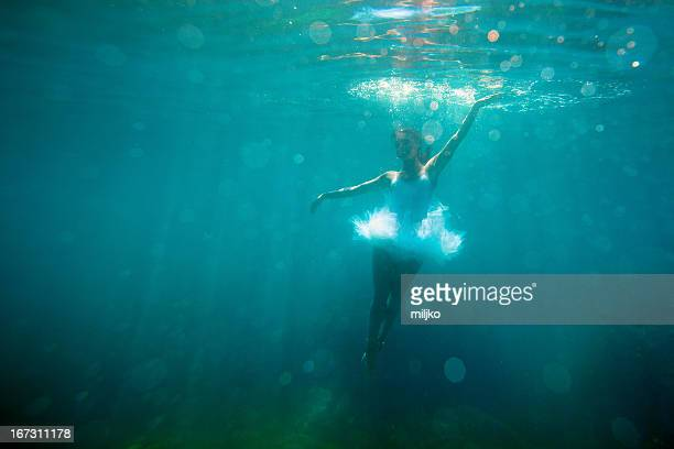 ballerina dancing under the water - under the skirt stock photos and pictures