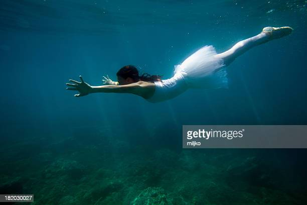 ballerina dancing under the water - under skirt stock photos and pictures