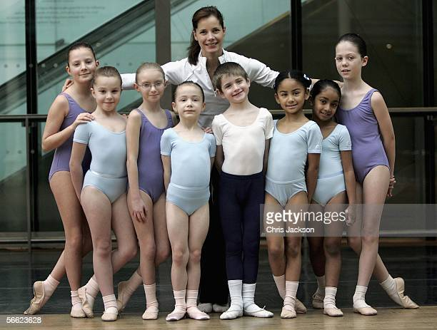 Ballerina Darcey Bussell poses for a photograph with children from the Royal Academy of Dance before the Critics' Circle National Dance Awards 2005...