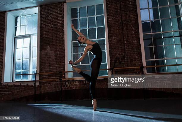 Ballerina doing Balance on pointe in dance studio