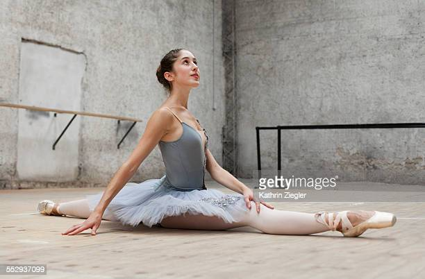ballerina doing the splits on the floor - doing the splits stock photos and pictures
