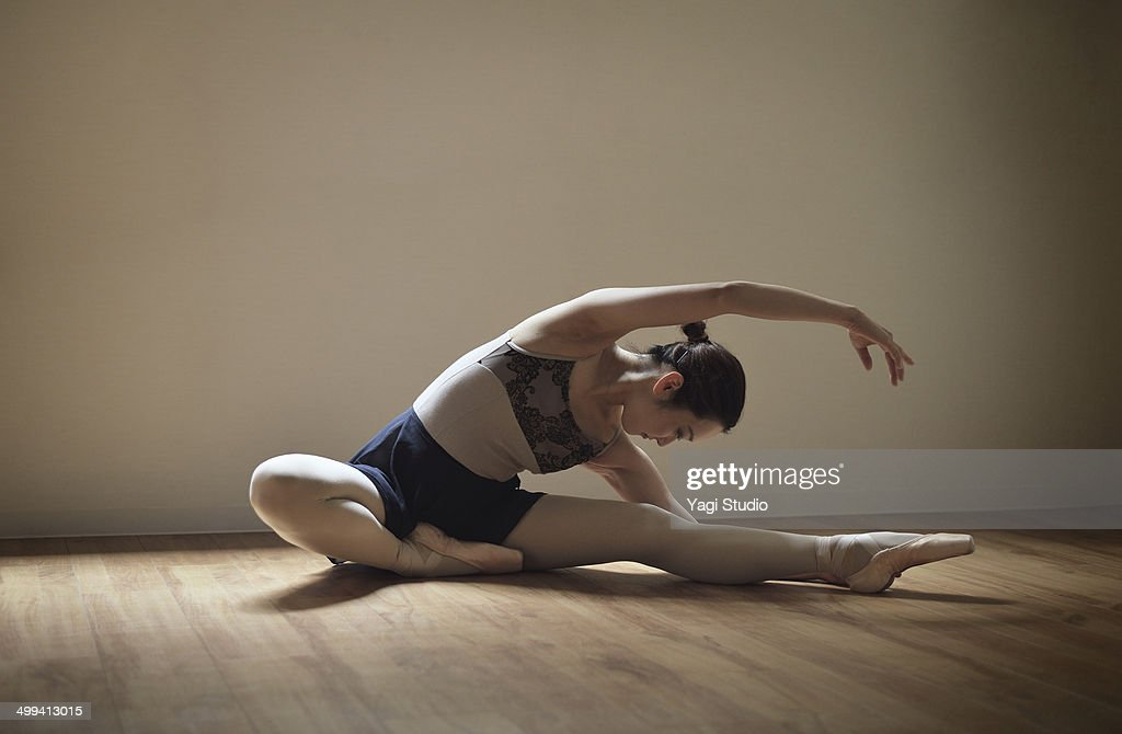 Ballerina exercising in studio : Stock Photo