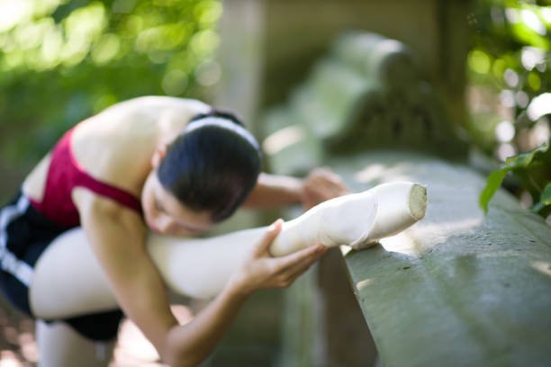 A ballerina girl doing exercise in nature