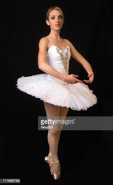 Ballerina in a dance position on black background