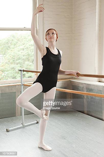 ballerina in a pose - teen girls in tights stock photos and pictures