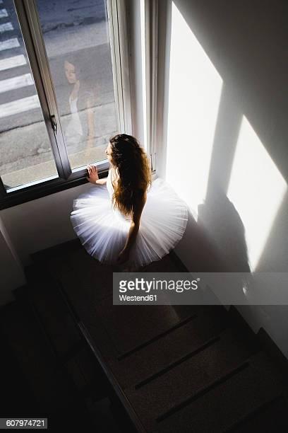 Ballerina in a tutu at the window