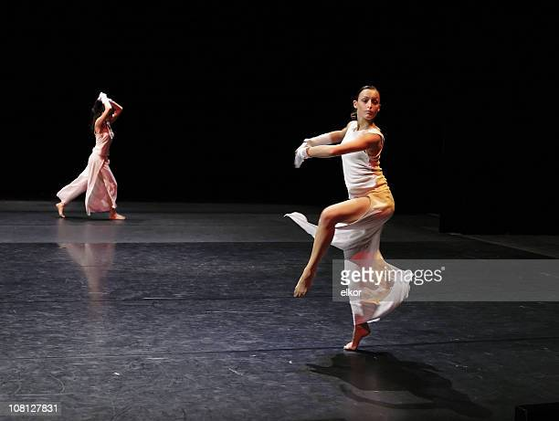 a ballerina in white executing a pirouette - musical theater stock pictures, royalty-free photos & images