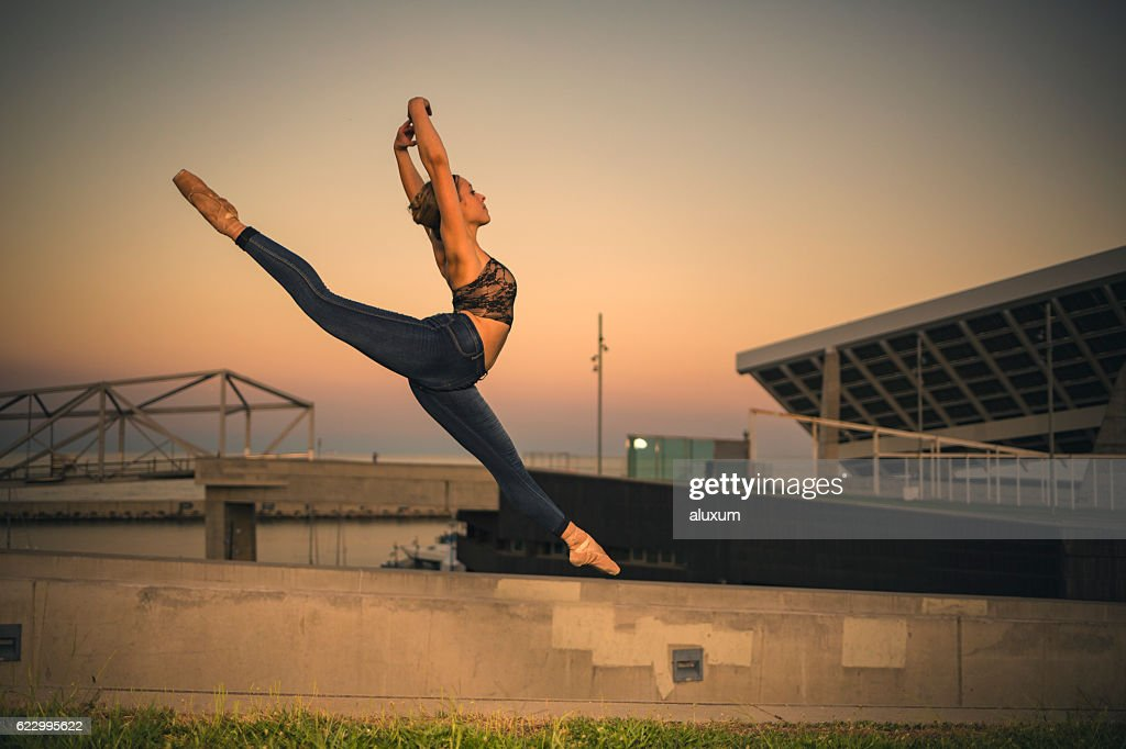 Ballerina jumping in the city : Stock Photo