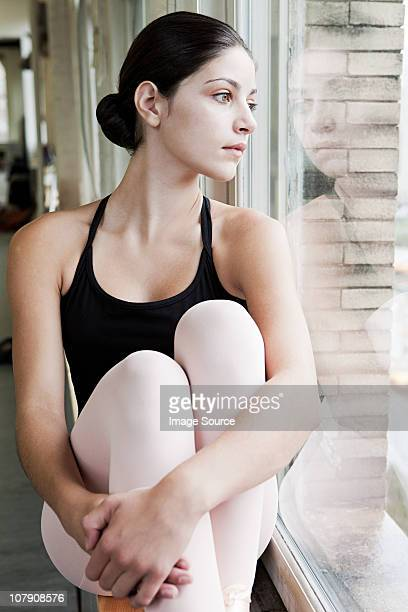 ballerina looking through window - teen girls in tights stock photos and pictures