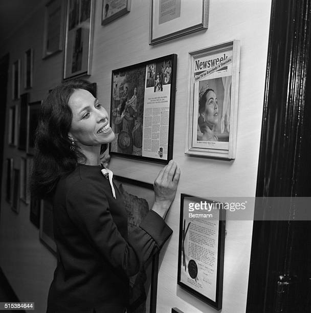 Ballerina Maria Tallchief at home looking over mementoes of her past career