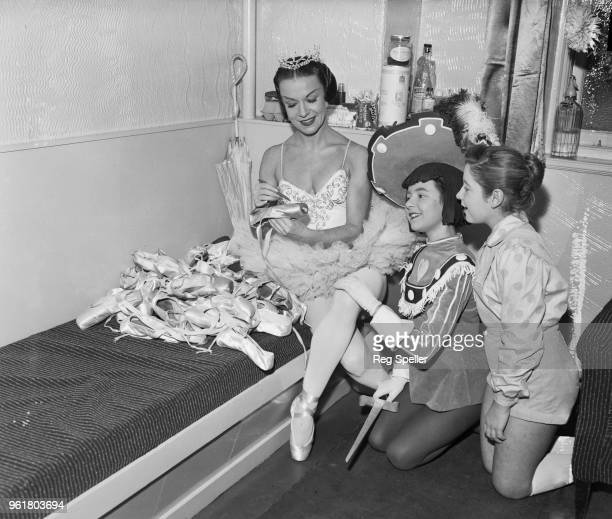 Ballerina Marina Svetlova autographs her old ballet shoes for Tawya Trude and Jill Carter from the Aida Foster Theatre School backstage at the London...