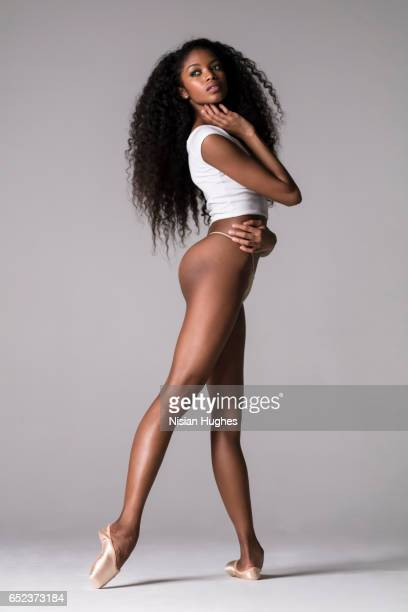 ballerina on pointe in studio - skinny black woman stock photos and pictures