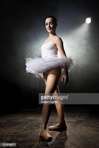 ballerina on stage under spotlight