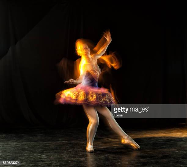 Ballerina on stage with ghosts