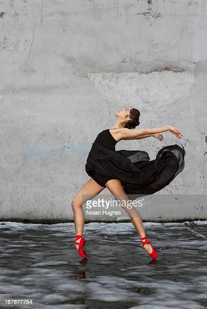 Ballerina performing Arch back on pointe outside