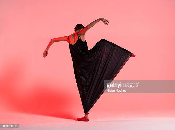 ballerina performing attitude a la seconde - long dress stock pictures, royalty-free photos & images