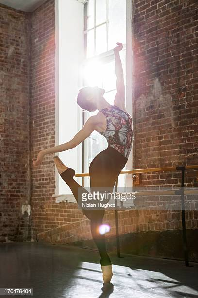 Ballerina performing Balance on pointe arch back