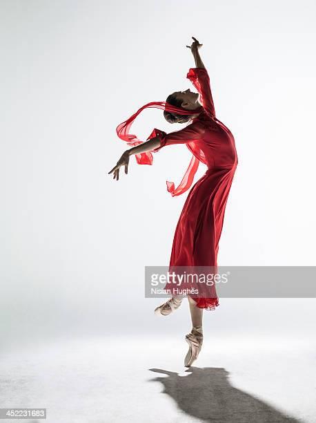 Ballerina performing coupe derriere en pointe