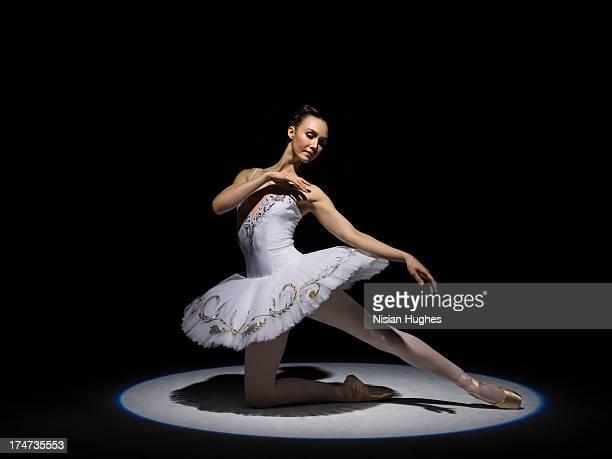 Ballerina performing half kneeling luge with tutu
