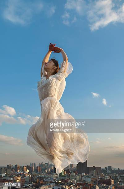 ballerina performing italian changement city below - long dress stock pictures, royalty-free photos & images