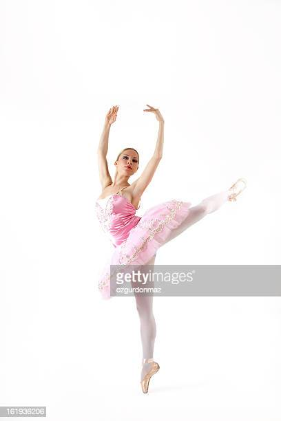 Ballerina performing on white background