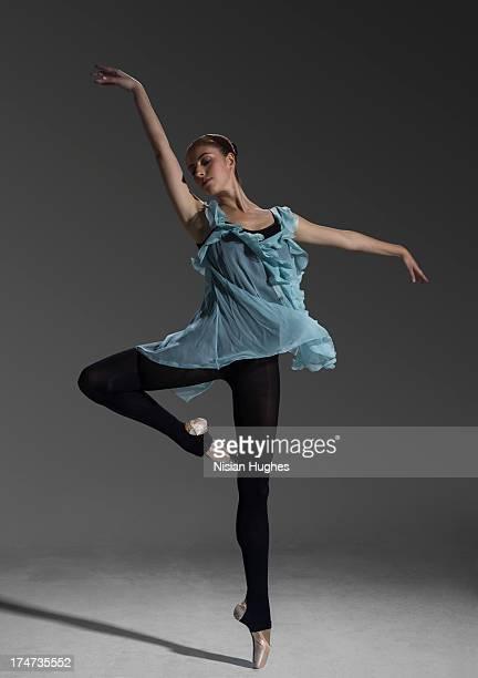 ballerina performing Passé Relevé in studio