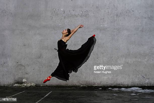 ballerina performing sissone outside - black dress stock pictures, royalty-free photos & images