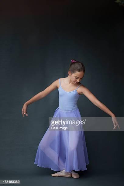 Ballerina posing in plie
