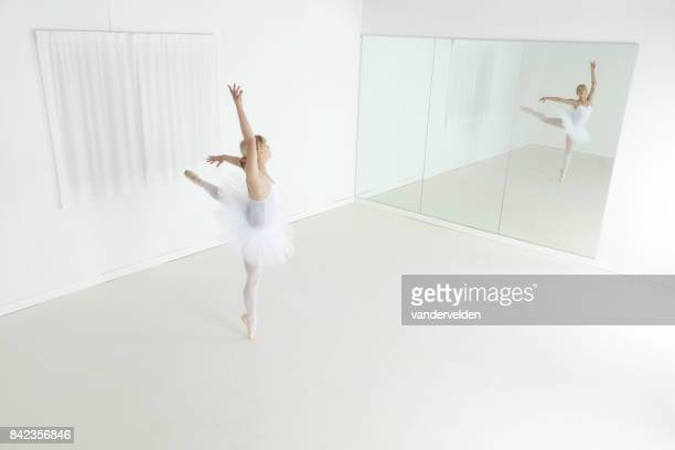 ballerina practising her steps - full length mirror stock photos and pictures