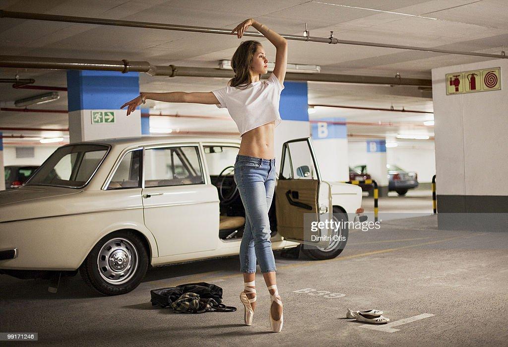 Ballerina practising in parking lot : Stock Photo
