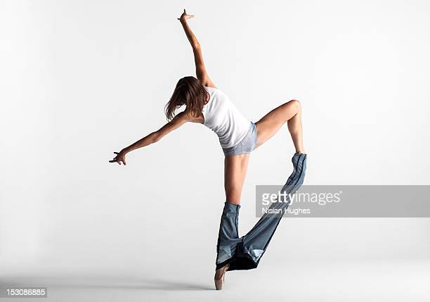 Ballerina pulling off her pants