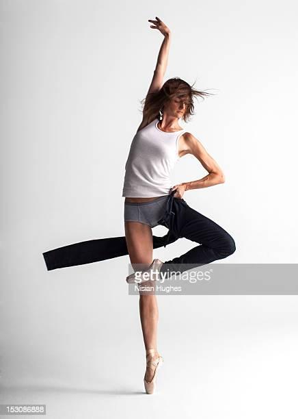 Ballerina pulling up pants
