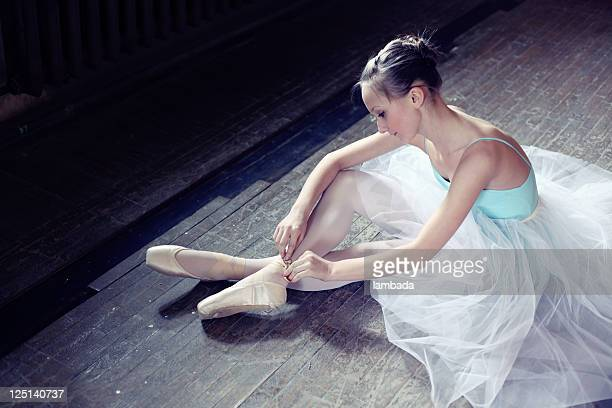 Ballerina putting on pointes