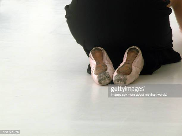 ballerina rests after difficult rehearsal, close-up of feet. - images of ugly feet stock photos and pictures