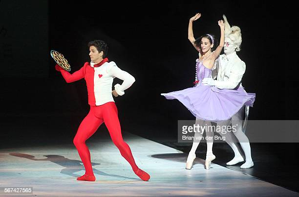 Ballerina Sonia Rodriguez as Alice and White Rabbit Aleksandar Antonijevic right with Guillaume Cote as the Knave of Hearts left perform in the...