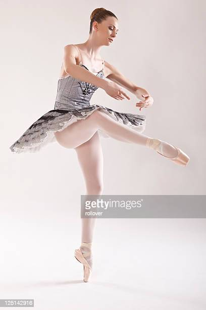 Ballerina standing on one le