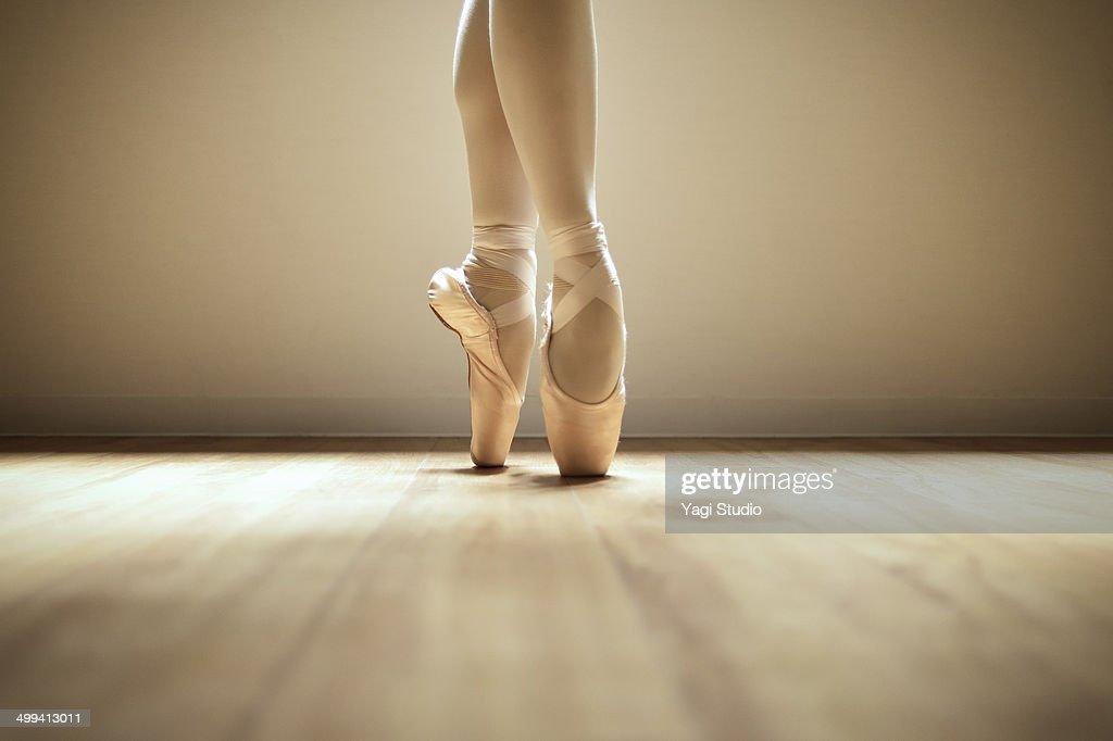 Ballerina standing on toes : Stock Photo